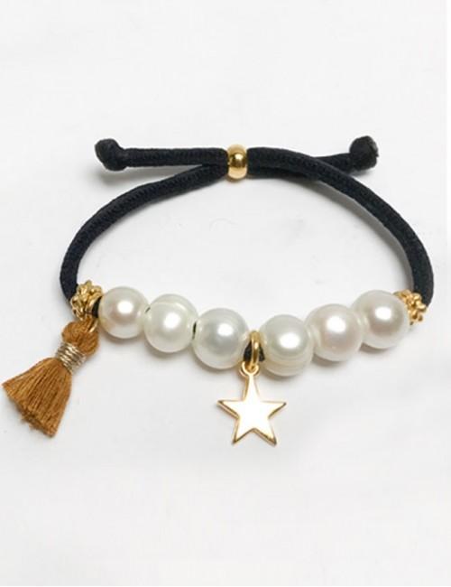pulsera elástico grueso en negro con perlas y estrella dorada