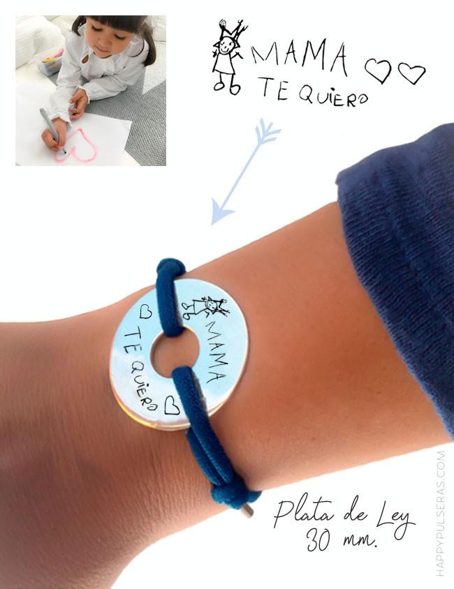 Pulsera donut de plata con cordón elástico seda azul marino para grabar un dibujo sobre la medalla. Happypulseras