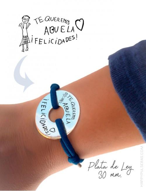 Pulsera donut de plata para regalar, se personalizan con un dibujo de un niño o un escrito a mano de un adulto.