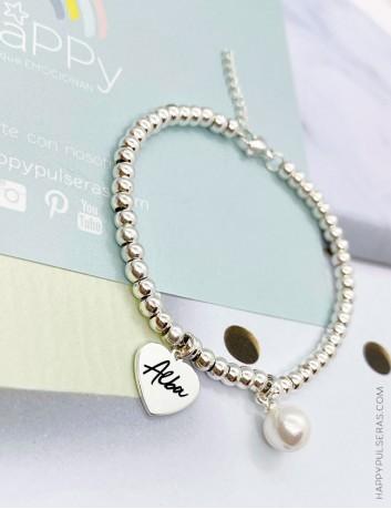 Regala esta pulsera de bolitas de acero blanco con corazón colgante para grabar la palabra que quieras, tu nombre, fecha...