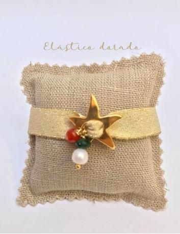pulsera con estrella mar dorada con elástico ancho plano en color dorado