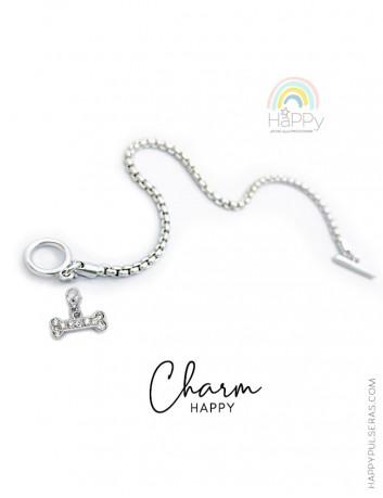 Añade los charms que te gusten a nuestras pulseras de acero de Happy. Huesito de perro de acero con piedras brillantes