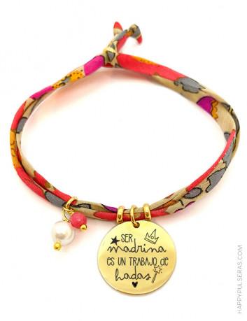 Pulsera liberty Happy de flores en tonos rojos. Medalla de acero dorado grabada a dos caras.