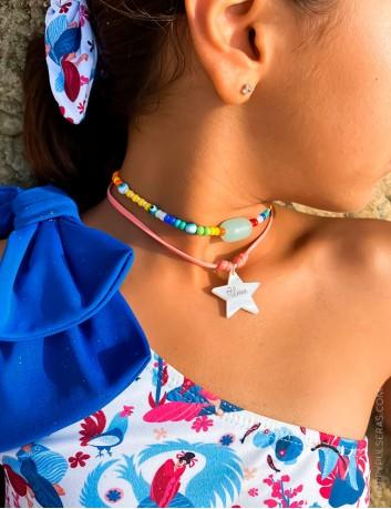 Collar estrella nácar con cordón en colores vivos. Grabamos tu nombre sobre la forma de abalocio que elijas.