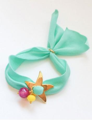 pulsera tela elástica lycra italiana de colores con estrella de mar dorada y bolitas de colores a juego